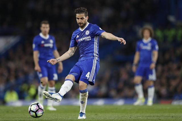 Chelsea's midfielder Cesc Fabregas passes the ball during an English Premier League football match against Middlesbrough at Stamford Bridge in London on May 8, 2017 (AFP Photo/Adrian DENNIS)
