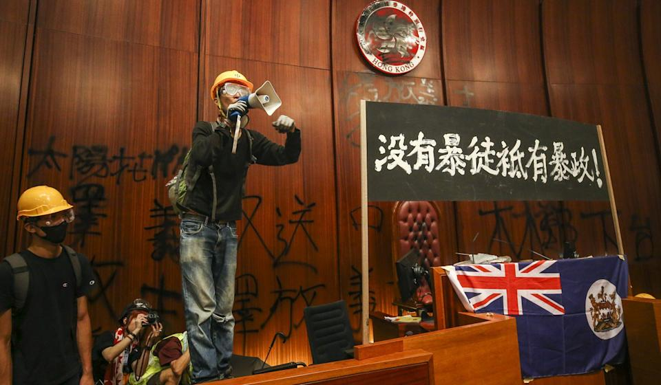 Banners put up and walls defaced in the Legco chamber. Photo: Winson Wong