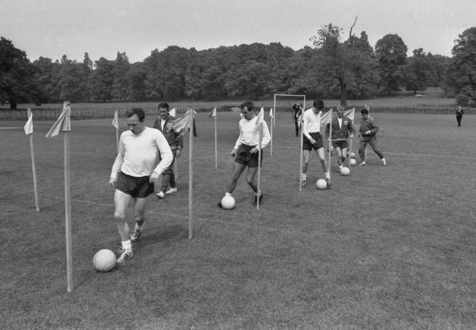 "Mr Alf Ramsey, the team manager has gathered 27 players together at Lilleshall, Shropshire, for 12 days of training. He will name 22 next Friday for the Continental tour, and these men, he says, ""will be the World Cup squad."" The problem is, which 5 to leave out? Mr Ramsey hopes to find the answer during the training, ""although it will be the hardest decision I have ever had to make."" Our photo shows the players being put through their paces during a training session. Nobby Stiles leads the way in a traditional dribbling exercise. 9th June 1966 (Photo by Coventry Telegraph Archive/Mirrorpix/Mirrorpix via Getty Images)"