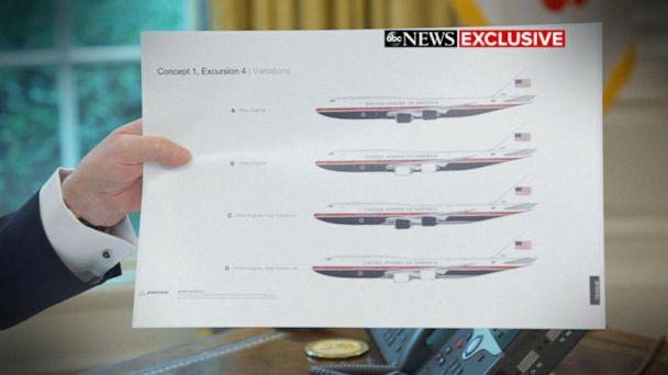 PHOTO: Donald Trump holds up pictures of the new Air Force One designs. (ABC News)