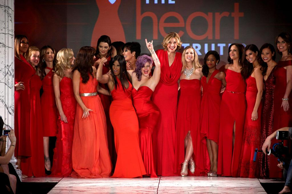 NEW YORK, NY - FEBRUARY 06: (L-R) Wendy Williams, Cindy Parsons, Jillian Michaels, Kendall Jenner, Kylie Jenner, Kris Jenner, Toni Braxton, Kelly Osbourne, Brenda Strong,Torah Bright , Gabrielle Douglas, Soledad O'Brien, Roselyn Sanchez, Jamie Chung, and Savannah Guthrie dance on the runway at The Heart Truth's Red Dress Collection during Fall 2013 Mercedes-Benz Fashion Week at Hammerstein Ballroom on February 6, 2013 in New York City.  (Photo by Thomas Concordia/WireImage)