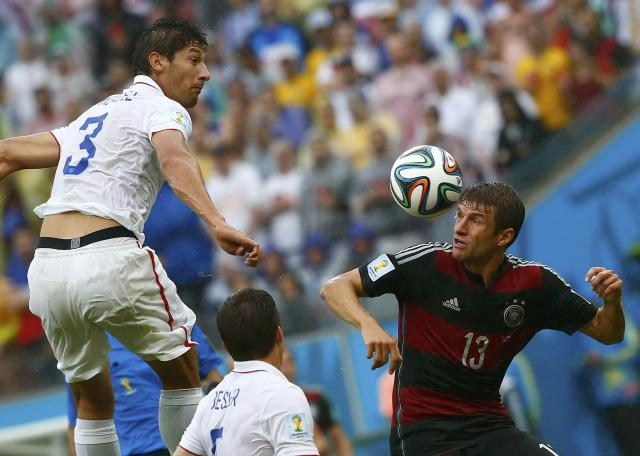 Omar Gonzalez of the U.S.(3) jumps for the ball with Germany's Thomas Mueller (R) during their 2014 World Cup Group G soccer match at the Pernambuco arena in Recife June 26, 2014. REUTERS/Tony Gentile (BRAZIL - Tags: SOCCER SPORT WORLD CUP)