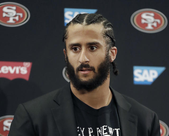 FILE - This Jan. 1, 2017, file photo shows then San Francisco 49ers quarterback Colin Kaepernick speaking at a news conference after the team's NFL football game against the Seattle Seahawks in Santa Clara, Calif. NFL spokesman Joe Lockhart says the league expects Colin Kaepernick to be invited to the next meeting between owners and players to discuss social justice initiatives. Lockhart adds that the meeting probably will take place next week. (AP Photo/Marcio Jose Sanchez, File)
