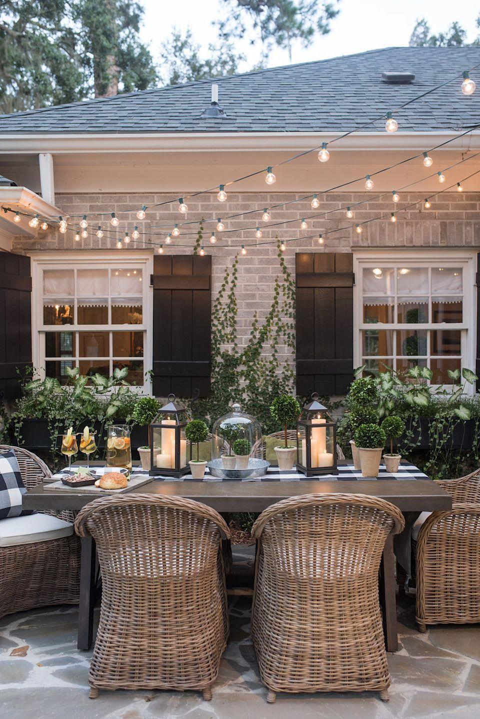 """<p>Create the perfect outdoor dining space for summer dinner parties with a few strands of string lights. Scatter some lanterns on the table, too, in order to achieve an outdoor candlelight glow.</p><p><strong>See more at</strong> <strong><a href=""""http://www.lavinlabel.com/2017/09/06/dog-days-summer/"""" rel=""""nofollow noopener"""" target=""""_blank"""" data-ylk=""""slk:Lavin Label"""" class=""""link rapid-noclick-resp"""">Lavin Label</a></strong><strong>.</strong></p><p><a class=""""link rapid-noclick-resp"""" href=""""https://www.amazon.com/Backyard-Hanging-Outdoor-Pergola-Deckyard/dp/B00RQHBZVS/ref=sr_1_12?tag=syn-yahoo-20&ascsubtag=%5Bartid%7C10050.g.3404%5Bsrc%7Cyahoo-us"""" rel=""""nofollow noopener"""" target=""""_blank"""" data-ylk=""""slk:SHOP STRING LIGHTS"""">SHOP STRING LIGHTS</a></p>"""
