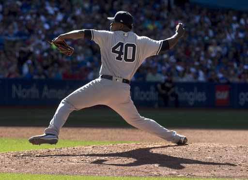 FILE - In this July 7, 2018, file photo, New York Yankees starting pitcher Luis Severino works against the Toronto Blue Jays during the fourth inning of a baseball game in Toronto. Two of the top pitchers in the American League square off when the Yankees begin a series in Cleveland. Two-time Cy Young Award winner Corey Kluber starts for the Indians, while the AL leader in wins, Severino, takes the mound for New York in a matchup of 2018 All-Stars. (Fred Thornhill/The Canadian Press via AP, File)