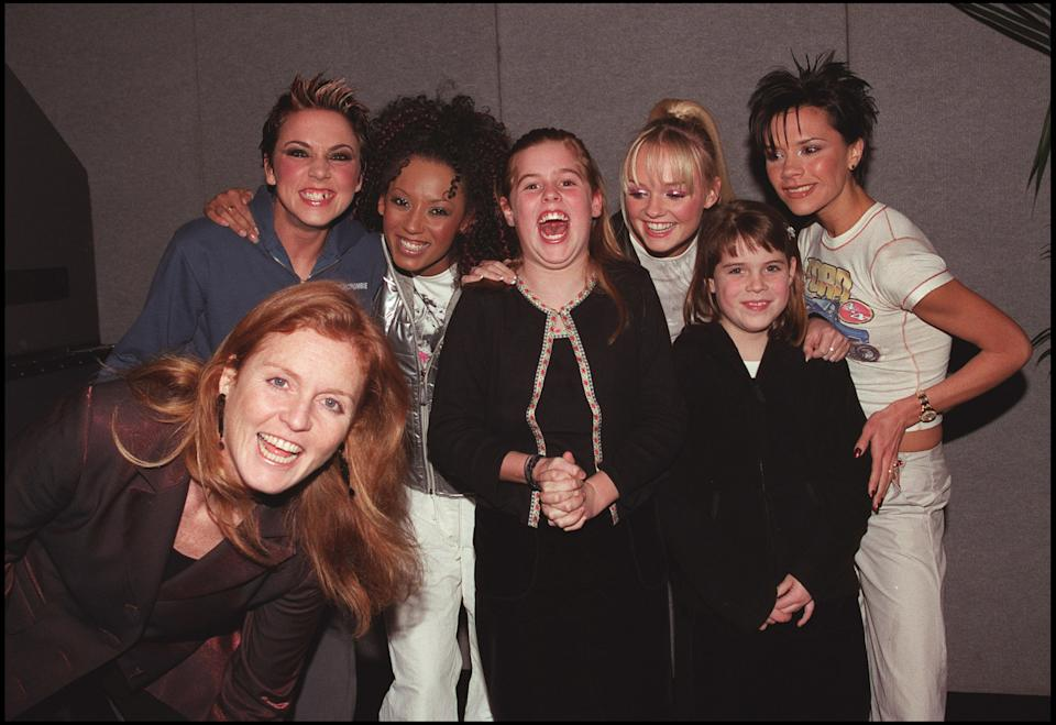 LONDON - DECEMBER 15: (Clockwise bottom L to R) The Duchess of York, Sarah Ferguson, Melanie Chisholm, Melanie Brown, Princess Eugenie, Emma Bunton, Princess Beatrice, and Victoria Adams pose backstage at the Spice Girls concert held at Earls Court in London on December 15, 1999. (Photo by Dave Hogan/Getty Images)