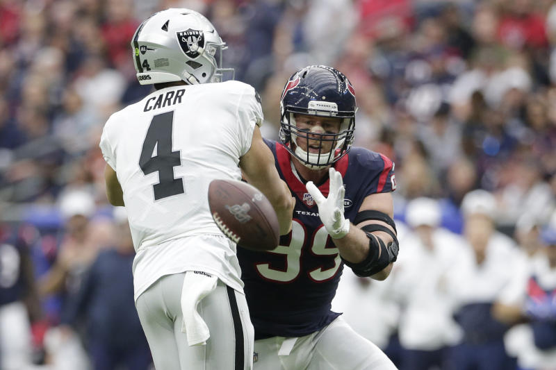 Texans defensive end J.J. Watt, right, suffered a torn pec in this October 27 game. He will return to practice on Tuesday. (AP/Michael Wyke)
