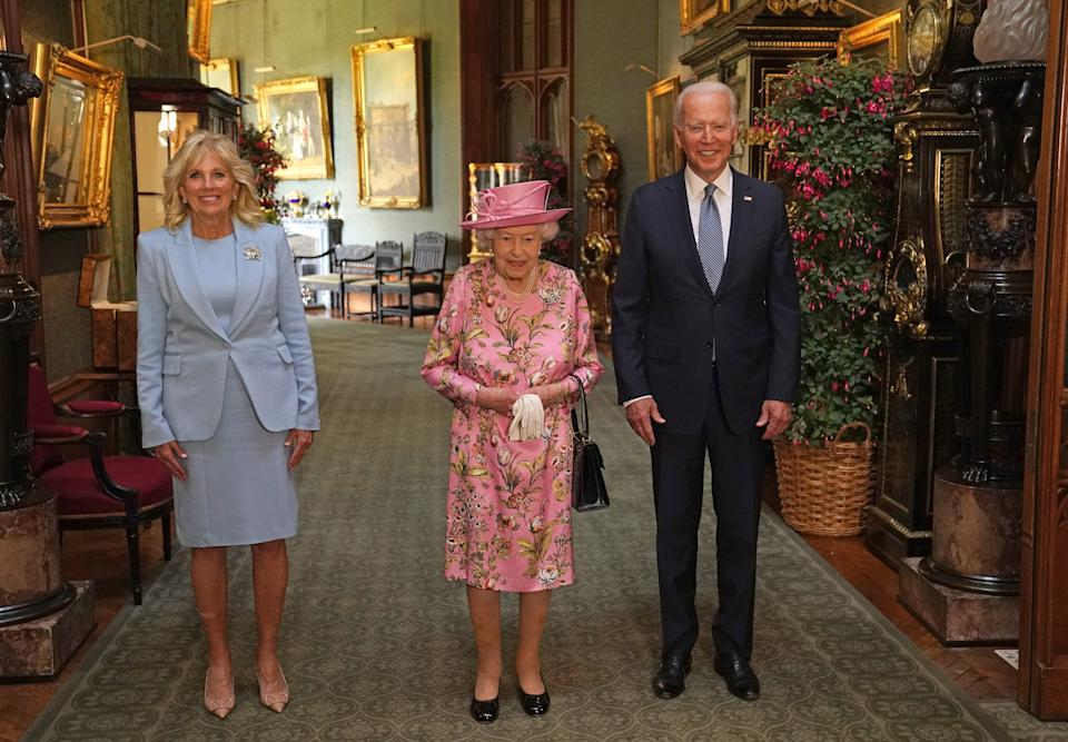 Queen Elizabeth II (center) with US President Joe Biden and First Lady Jill Biden in the Grand Corridor during their visit to Windsor Castle in Berkshire.  Picture date: Sunday June 13, 2021.