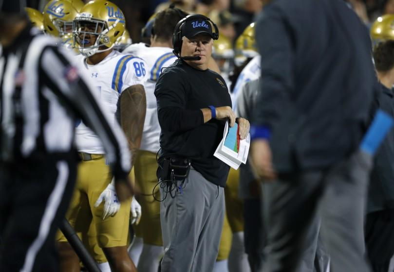 UCLA coach Chip Kelly watches during the first half of the team's NCAA college football game against Colorado.
