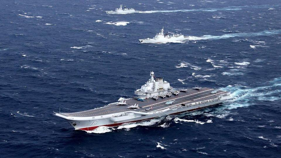 The Liaoning aircraft carrier with accompanying fleet conducts a drill in an area of South China Sea, in this undated photo taken in December 2016.