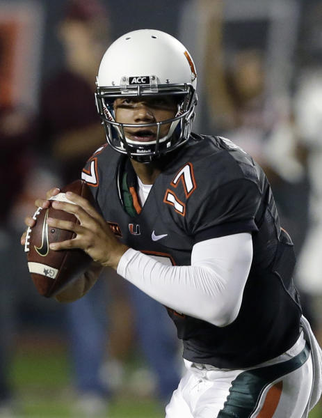 Miami quarterback Stephen Morris drops back to pass during the first half of an NCAA college football game against Virginia Tech, Saturday, Nov. 9, 2013, in Miami Gardens, Fla. (AP Photo/Wilfredo Lee)