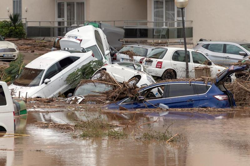 Cars are submerged in Majorca (EPA)