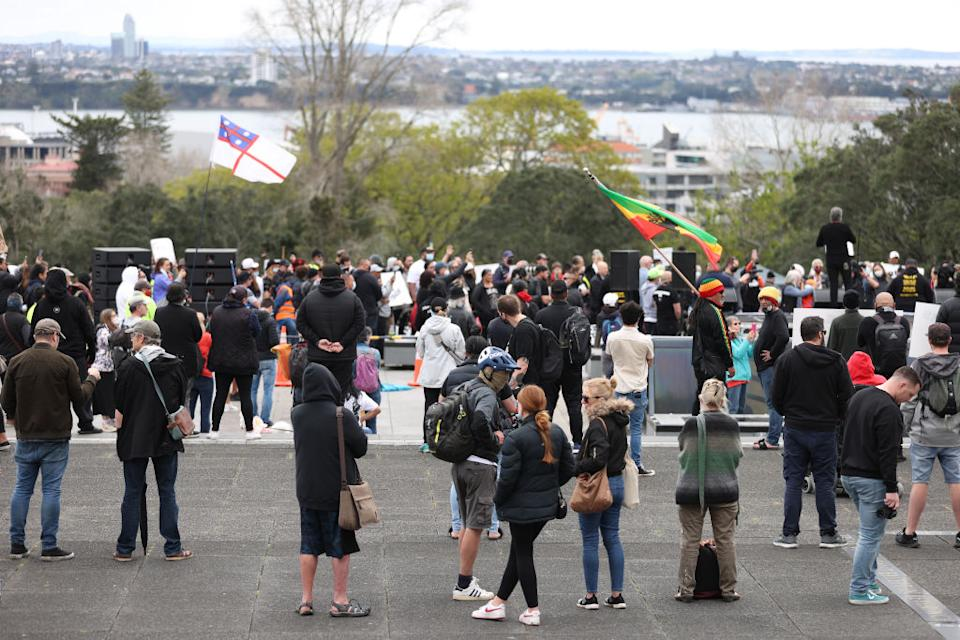 People gather in front of Auckland War Memorial museum to rally against lockdowns in Auckland, New Zealand.