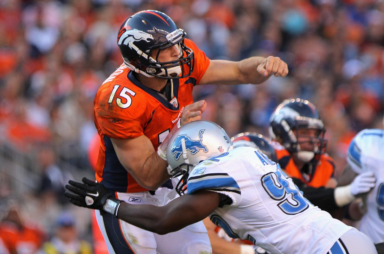 DENVER, CO - OCTOBER 30:  Quarterback Tim Tebow #15 of the Denver Broncos is hit by Cliff Avril #92 of the Detroit Lions as he delivers a pass Sports Authority at Invesco Field at Mile High on October 30, 2011 in Denver, Colorado. The Lions defeated the Broncos 45-10.  (Photo by Doug Pensinger/Getty Images)