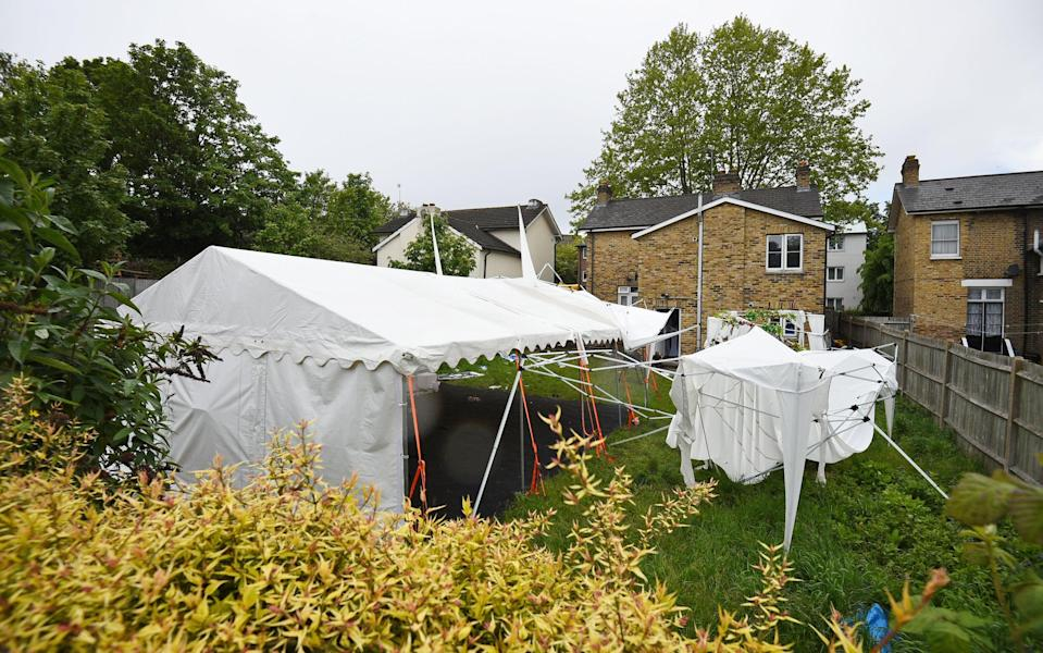 A tent in the garden of a house in Consort Road, Peckham, police officers investigating the shooting of black equal rights activist Sasha JohnsonPA Wire