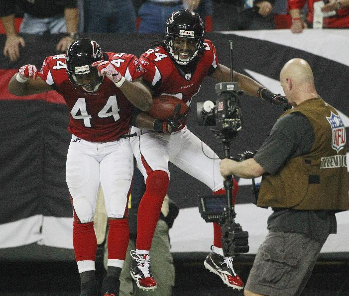 Atlanta Falcons wide receiver Roddy White (84) celebrates his touchdown with Atlanta Falcons running back Jason Snelling (44) during the second  half of an NFL football game Thursday, Dec. 15, 2011, in Atlanta. (AP Photo/John Bazemore)