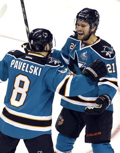 San Jose Sharks' Joe Pavelski, left, celebrates a goal with TJ Galiardi during the first period of an NHL hockey game against the Anaheim Ducks, Wednesday, March 27, 2013 in San Jose, Calif. (AP Photo/George Nikitin)