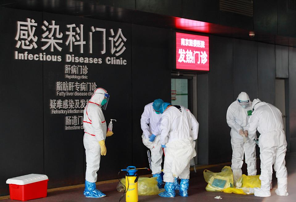 Chinese doctors disinfect for prevention of the new coronavirus and pneumonia before entering the infectious disease and fever clinic at a hospital during the Chinese New Year or Spring Festival holiday in Nanjing City.