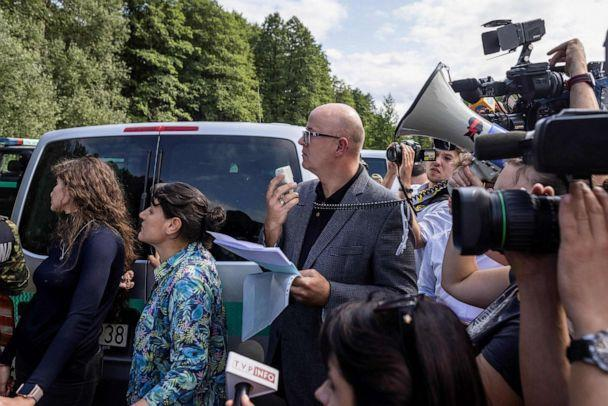 PHOTO:Volunteer Polish lawyers try to communicate with a group of migrants believed to be from Afghanistan to confirm their desire to apply for international protection in Poland in the village of Usnarz Gorny in northeastern Poland, Aug. 20, 2021. (Wojtek Radwanski/AFP via Getty Images)
