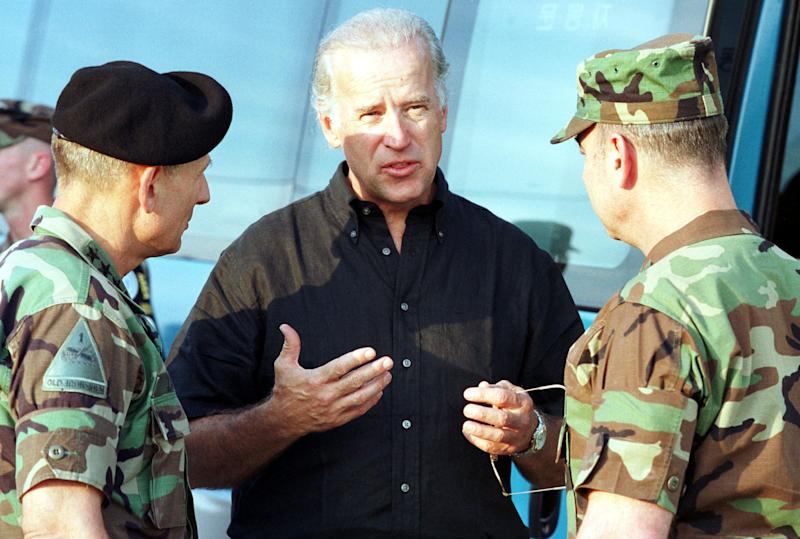 Biden talks with Lt. Gen. Daniel Zanini, commander of 8th Army chief of staff of UNC & USFK, left, and Lt. Gen. William Miller, UNC security battalion commander, on Aug. 11, 2001, at the border village of Panmunjom, South Korea.