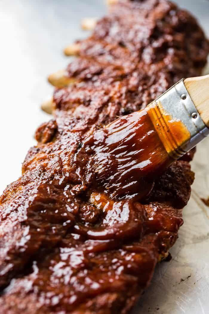 "<strong>Get the <a href=""https://ohsweetbasil.com/smoky-bbq-instant-pot-ribs-recipe/"" rel=""nofollow noopener"" target=""_blank"" data-ylk=""slk:Smoky BBQ Instant Pot Ribs"" class=""link rapid-noclick-resp"">Smoky BBQ Instant Pot Ribs</a> recipe from Oh, Sweet Basil.</strong>"
