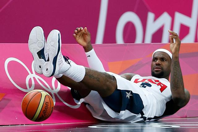 Lebron James #6 of United States falls to the ground after a play against France during their Men's Basketball Game on Day 2 of the London 2012 Olympic Games at the Basketball Arena on July 29, 2012 in London, England. (Photo by Jamie Squire/Getty Images)