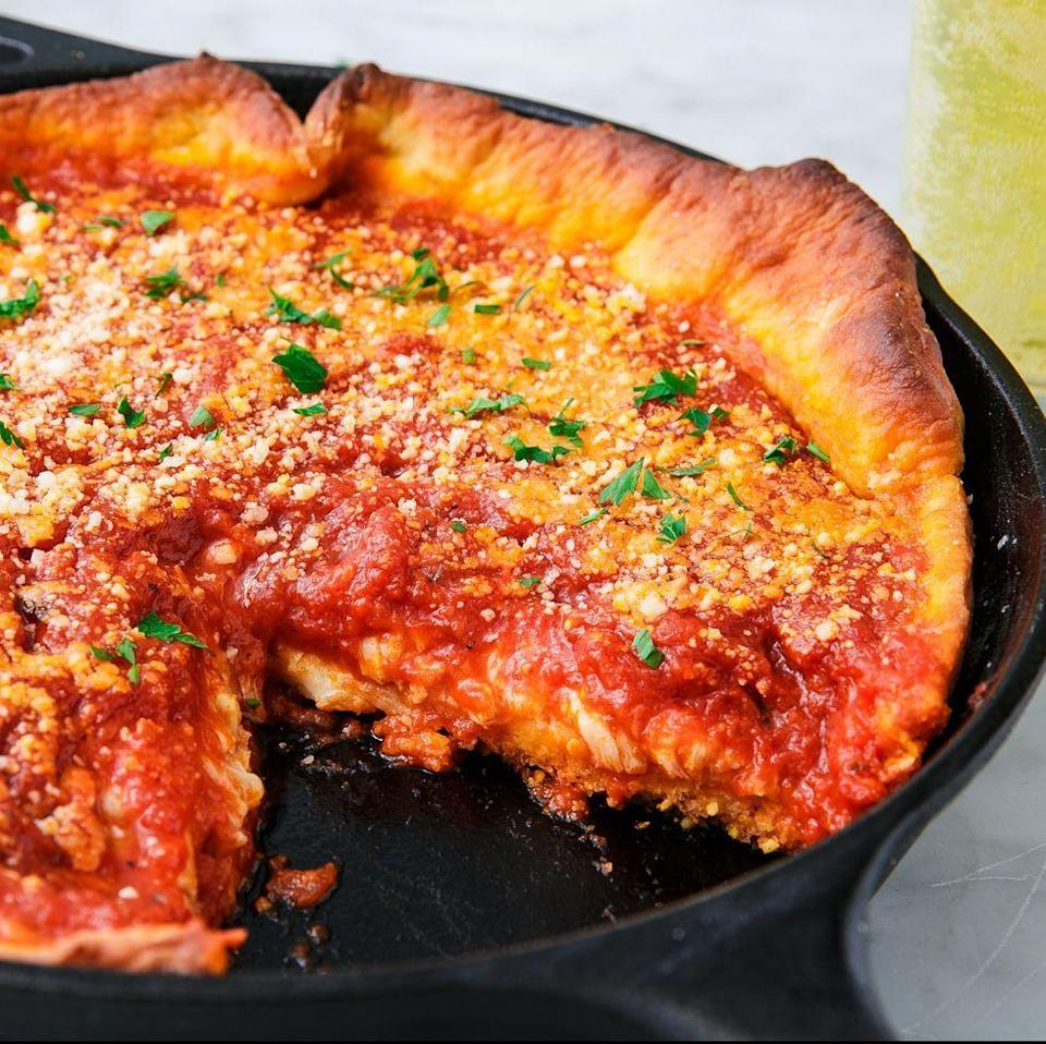 """<p>Homemade pizza night calls for something extra special and this deep dish pizza is just the thing! Dress it up anyway you want and add a layer of your favourite topping under the sauce! </p><p>Get the <a href=""""https://www.delish.com/uk/cooking/recipes/a30386507/deep-dish-pizza-recipe/"""" rel=""""nofollow noopener"""" target=""""_blank"""" data-ylk=""""slk:Deep Dish Pizza"""" class=""""link rapid-noclick-resp"""">Deep Dish Pizza</a> recipe.</p>"""