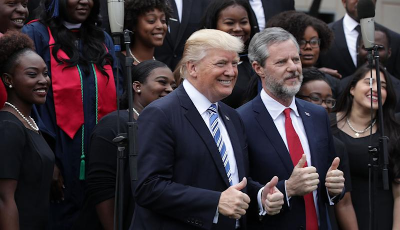 President Donald Trump and Jerry Falwell Jr., president of Liberty University, with members of a gospel choir during a May 13, 2017, commencement in Lynchburg, Virginia.