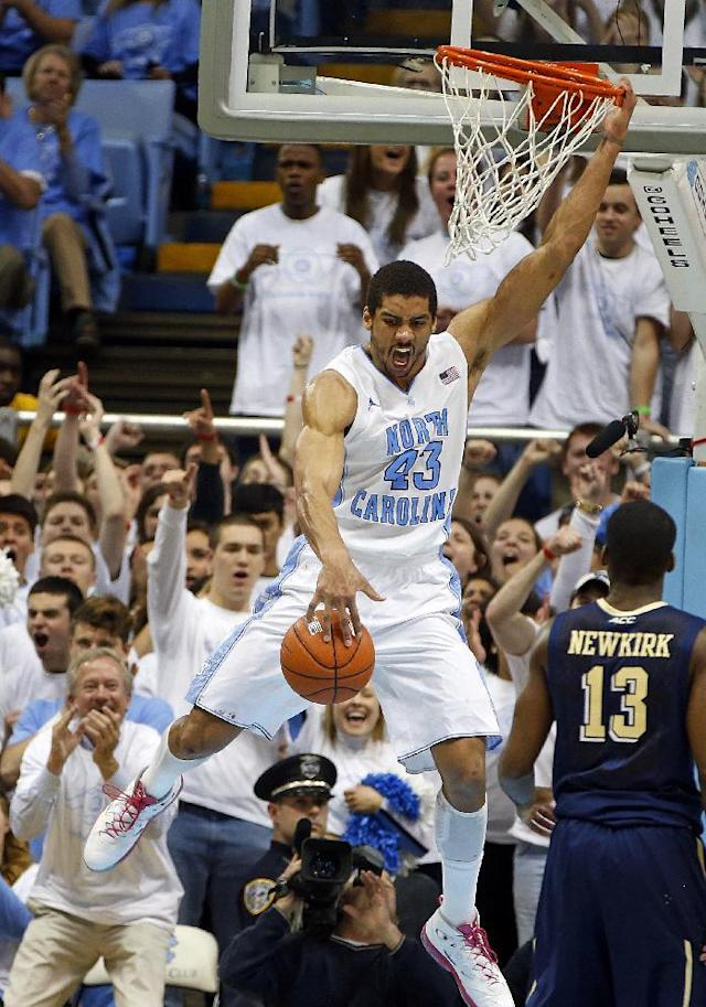North Carolina's James Michael McAdoo (43) slams the ball over Pittsburgh's Josh Newkirk (13) during the second half of an NCAA college basketball game in Chapel Hill, N.C., Saturday, Feb. 15, 2014. McAdoo had 24 points and 12 rebounds in North Carolina's 75-71 win. (AP Photo/Karl B DeBlaker)