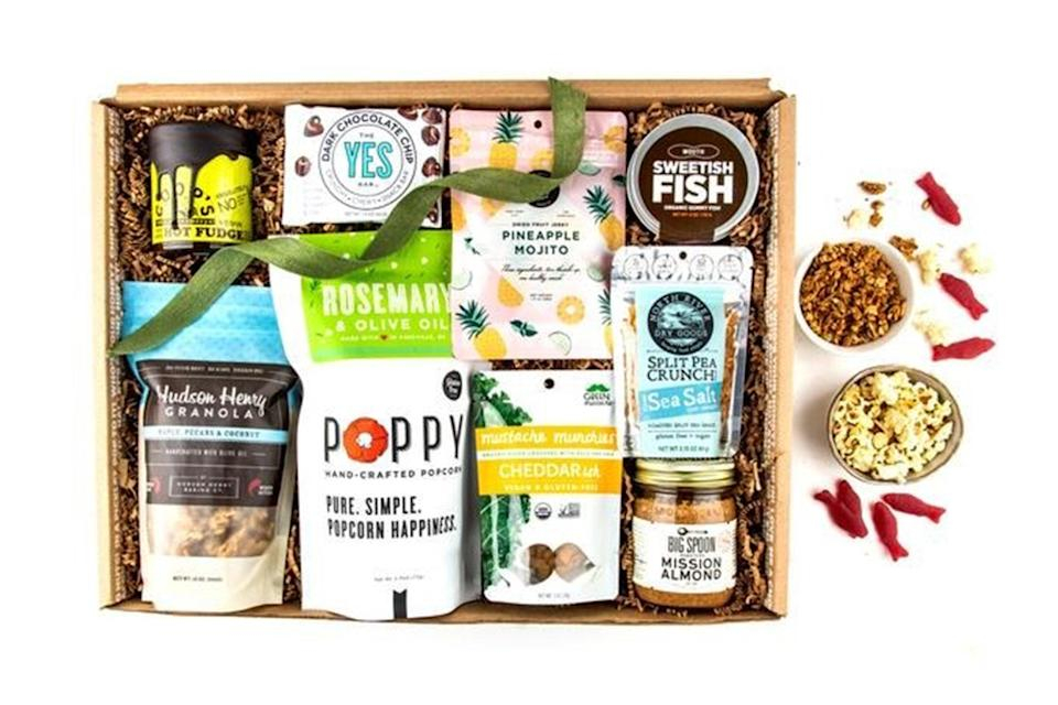"""It was one thing to hit the snacks at our office, but being at home for extended periods of time means the goodies are <em>always</em> within arm's reach. For better-for-you snacks, check out Mouth. The <a href=""""https://www.glamour.com/gallery/best-snack-subscription-boxes?mbid=synd_yahoo_rss"""" rel=""""nofollow noopener"""" target=""""_blank"""" data-ylk=""""slk:snack subscription box"""" class=""""link rapid-noclick-resp"""">snack subscription box</a> is vegan-friendly, but both its sweet and savory treats actually taste great. Think almond butter, crunchy split peas, hot fudge sauce, and more. $107, Mouth. <a href=""""https://www.mouth.com/products/vegan-snack-box-gift-box#variant=411060861"""" rel=""""nofollow noopener"""" target=""""_blank"""" data-ylk=""""slk:Get it now!"""" class=""""link rapid-noclick-resp"""">Get it now!</a>"""