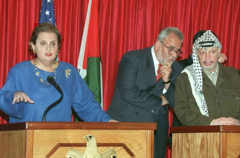 In this file photo taken on October 7, 1998, then Palestinian Authority President Yasser Arafat listens to a translation of US Secretary of State Madeleine Albright press conference by senior Palestinian negotiator Saeb Erekat in Jericho