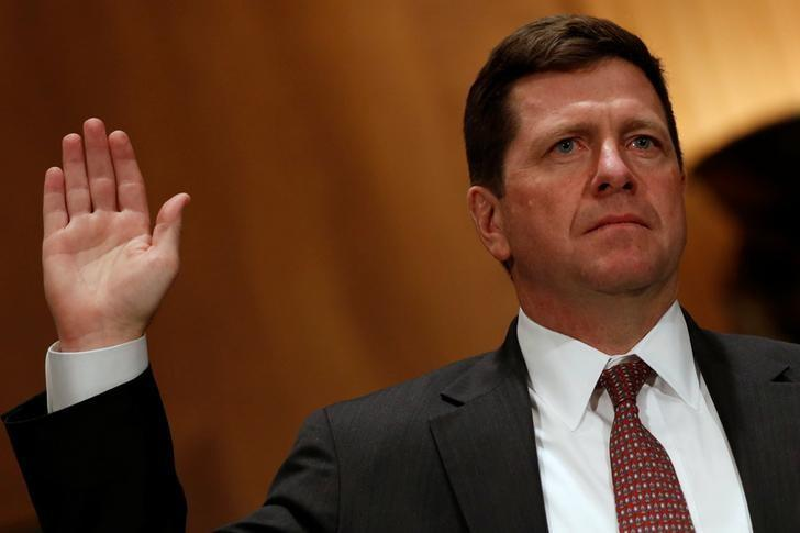 Clayton is sworn in to testify at a Senate Banking, Housing and Urban Affairs Committee hearing on his nomination of to be chairman of the Securities and Exchange Commission (SEC) on Capitol Hill in Washington