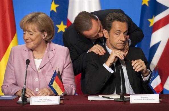 Italian Prime Minister Silvio Berlusconi (C) speaks with France's President Nicolas Sarkozy and German Chancellor Angela Merkel (L) during a news conference following a summit to discuss the international financial crisis at the Elysee Palace October 4, 2008.