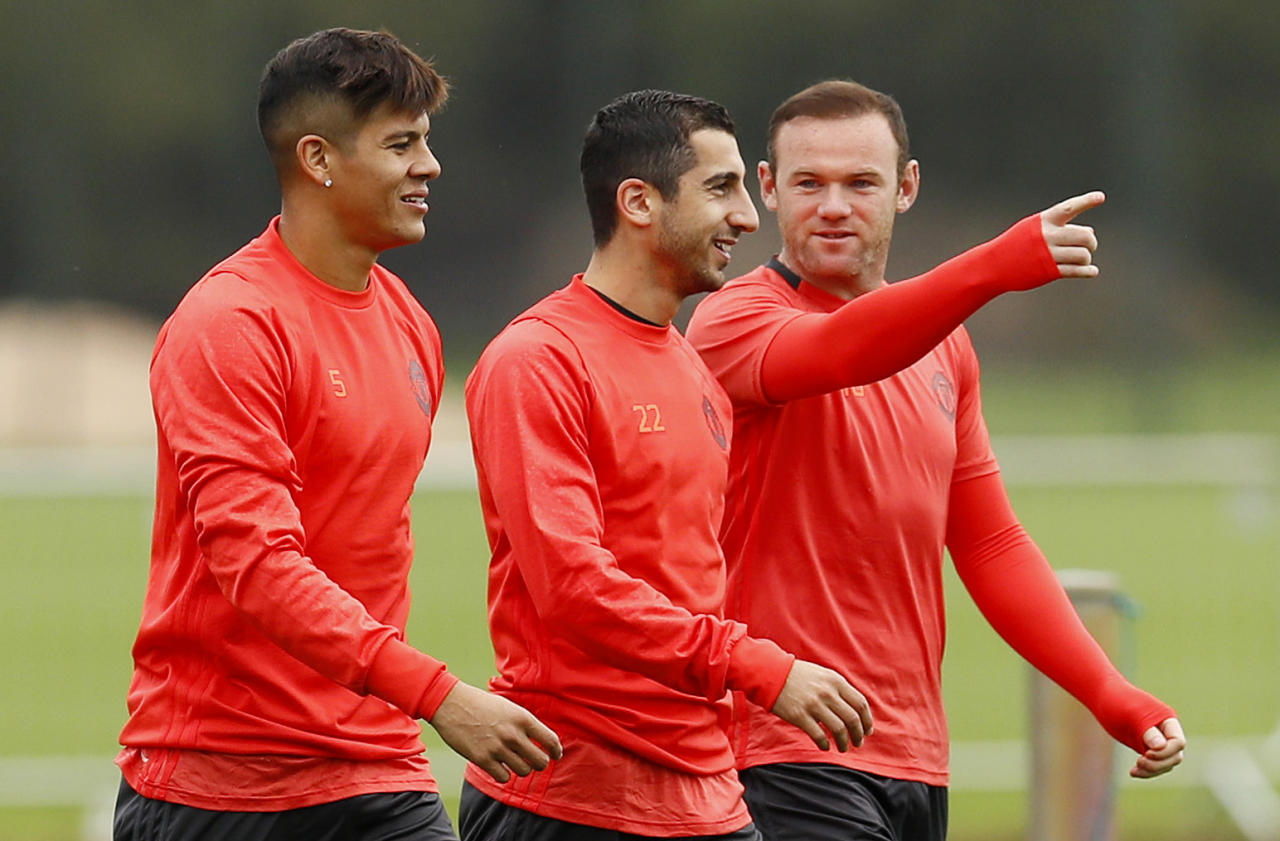 Britain Soccer Football - Manchester United Training - Manchester United Training Ground - 28/9/16 Manchester United's Marcos Rojo, Henrikh Mkhitaryan and Wayne Rooney during training Action Images via Reuters / Jason Cairnduff Livepic EDITORIAL USE ONLY.