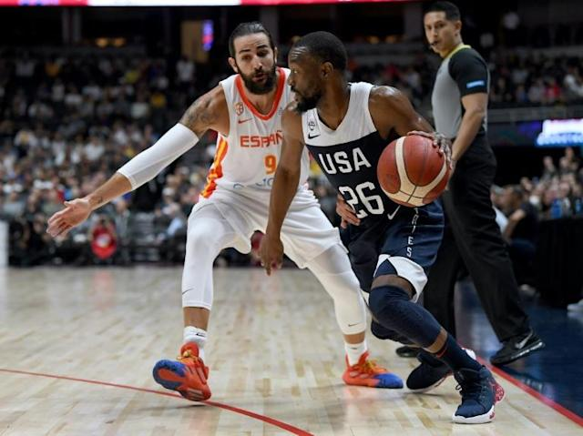 Kemba Walker of the United States (R) drives on Spain's Ricky Rubio in the first half of the USA's 90-81 exhibition win in Anaheim, California (AFP Photo/Harry How)