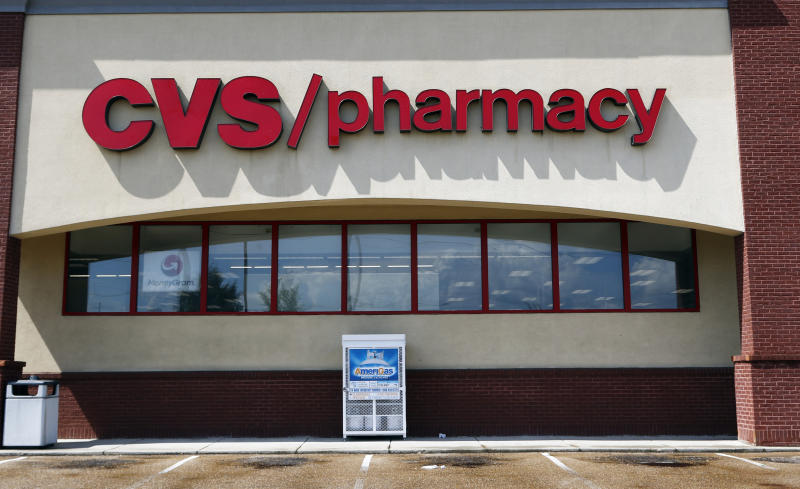 FILE- In this Aug. 7, 2018, file photo a CVS Pharmacy building sign rests on a Jackson, Miss., store. CVS has halted sales of popular heartburn treatment Zantac and the store generic version after warnings by U.S. health regulators. Earlier this month, the U.S. Food and Drug Administration warned consumers about a potentially dangerous contaminant in prescription and over-the-counter versions of Zantac.  In its announcement this weekend, CVS said customers who bought Zantac products can return them for a refund.  (AP Photo/Rogelio V. Solis, File)