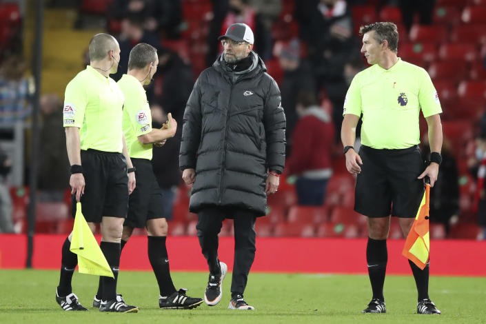 Liverpool's manager Jurgen Klopp speaks with the referee and linesmen at the end of an English Premier League soccer match between Liverpool and West Bromwich Albion at the Anfield stadium in Liverpool, England, Sunday Dec. 27, 2020. (Nick Potts/Pool via AP)