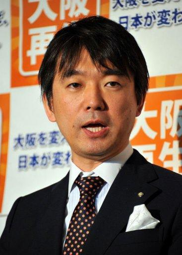 """Japan's Osaka Mayor Toru Hashimoto speaks to reporters in Tokyo in April 2012. The 42-year-old former corporate lawyer thinks Japan needs a dictatorship. He topped a list of politicians """"most suitable"""" to lead Japan, well ahead of Prime Minister Yoshihiko Noda"""