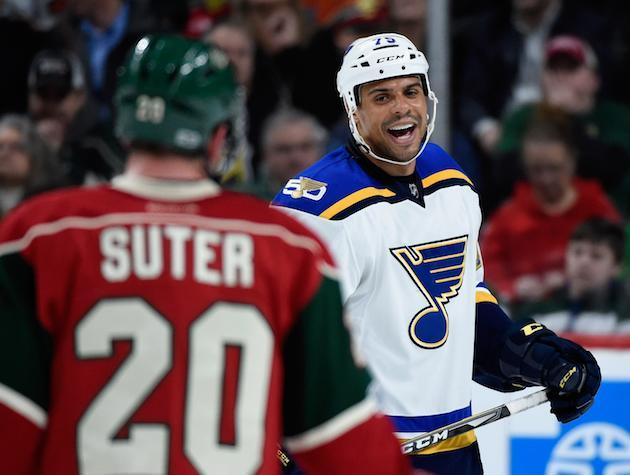 "ST PAUL, MN – MARCH 07: <a class=""link rapid-noclick-resp"" href=""/nhl/players/4186/"" data-ylk=""slk:Ryan Reaves"">Ryan Reaves</a> #75 of the St. Louis Blues talks to <a class=""link rapid-noclick-resp"" href=""/nhl/players/3345/"" data-ylk=""slk:Ryan Suter"">Ryan Suter</a> #20 of the <a class=""link rapid-noclick-resp"" href=""/nhl/teams/min/"" data-ylk=""slk:Minnesota Wild"">Minnesota Wild</a> before a face-off during the third period of the game on March 07, 2017 at Xcel Energy Center in St Paul, Minnesota. The Blues defeated the Wild 2-1. (Photo by Hannah Foslien/Getty Images)"