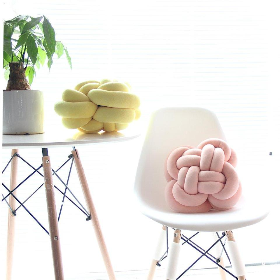 """An air of modern-whimsy is only one cotton-blended, knotted accent pillow away.<br><br><strong>ZANYB</strong> Soft Knot Ball Throw Pillow, $, available at <a href=""""https://amzn.to/3gYxhKL"""" rel=""""nofollow noopener"""" target=""""_blank"""" data-ylk=""""slk:Amazon"""" class=""""link rapid-noclick-resp"""">Amazon</a>"""
