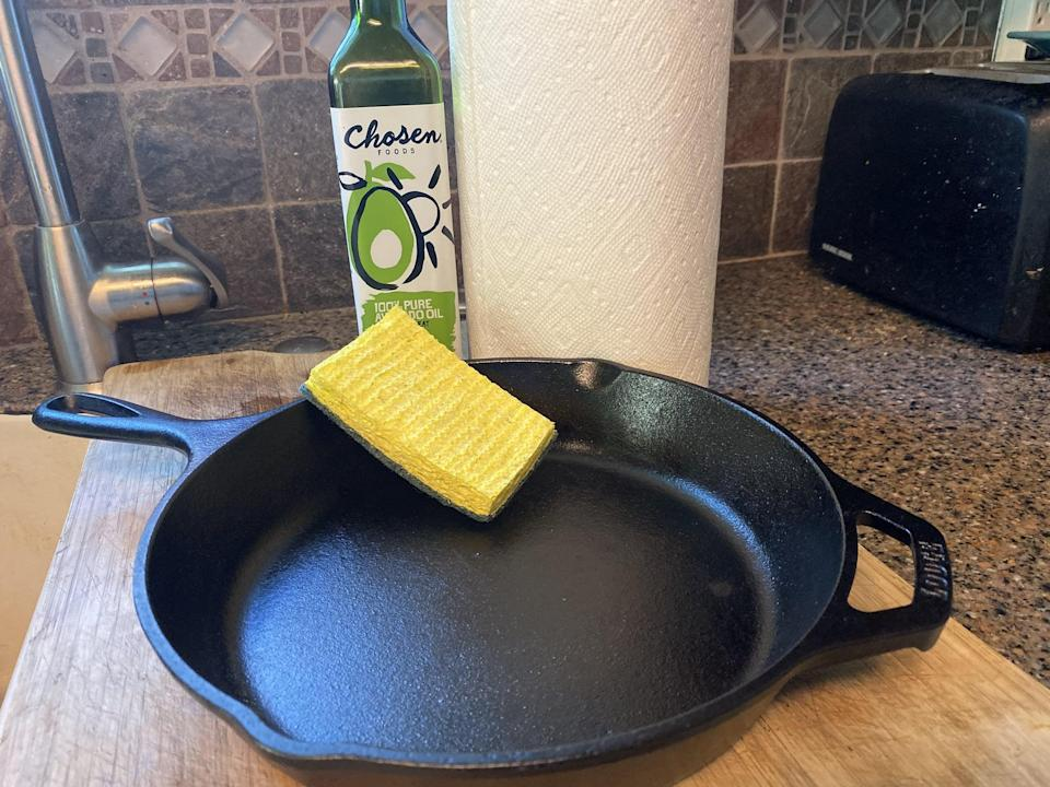 """<p>There are just a few simple household items you need to clean a <a href=""""https://www.popsugar.com/food/difference-between-regular-preseasoned-cast-iron-skillet-47980260"""" class=""""link rapid-noclick-resp"""" rel=""""nofollow noopener"""" target=""""_blank"""" data-ylk=""""slk:cast iron skillet"""">cast iron skillet</a>: paper towels, a soft sponge with an abrasive side, and oil that can take high heat like avocado oil.</p>"""