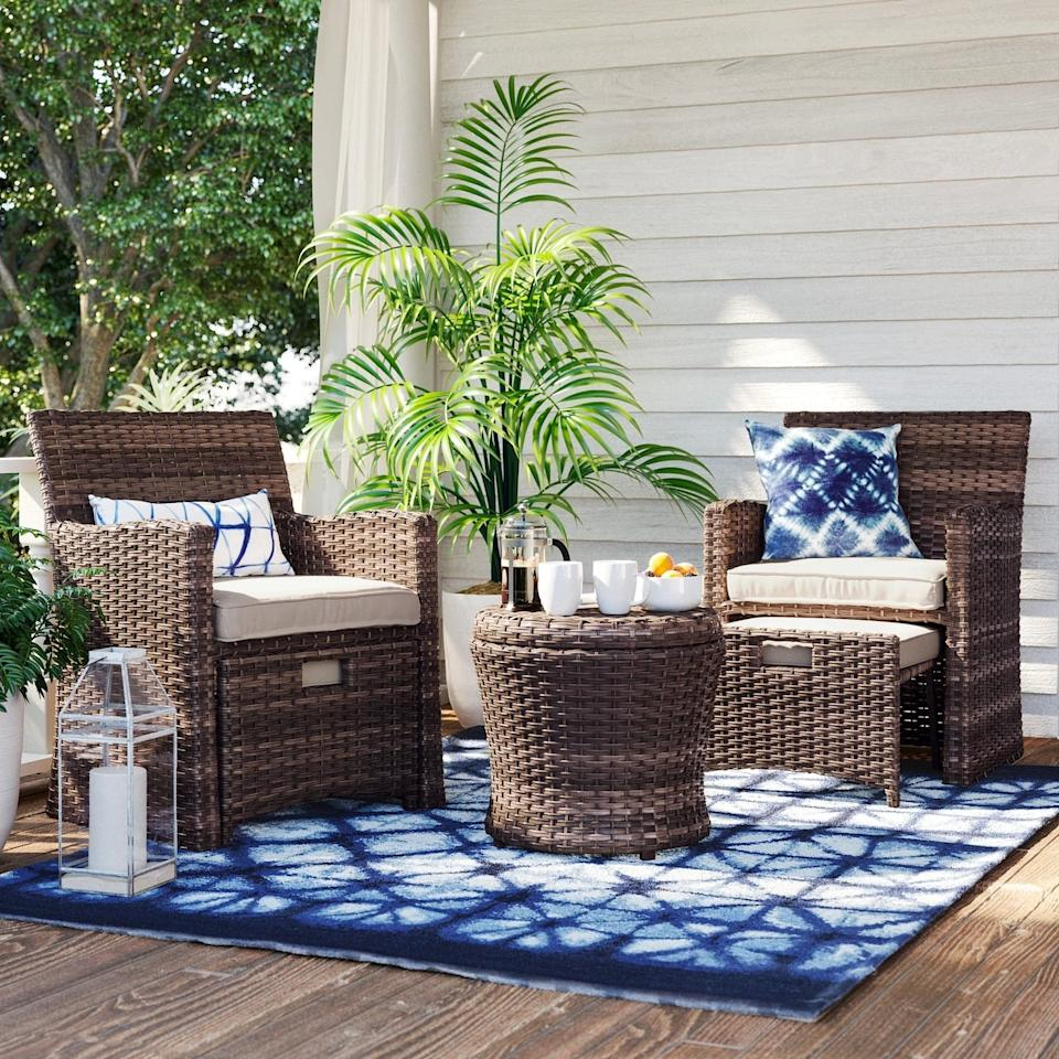 """<p>The ottomans that come with this <a href=""""https://www.popsugar.com/buy/Halsted-Wicker-Small-Space-Patio-Furniture-Set-446211?p_name=Halsted%20Wicker%20Small%20Space%20Patio%20Furniture%20Set&retailer=target.com&pid=446211&price=550&evar1=casa%3Aus&evar9=46144610&evar98=https%3A%2F%2Fwww.popsugar.com%2Fhome%2Fphoto-gallery%2F46144610%2Fimage%2F46144616%2FHalsted-Wicker-Small-Space-Patio-Furniture-Set&list1=shopping%2Ctarget%2Csmall%20spaces%2Csmall%20space%20living%2Capartment%20living%2Coutdoor%20decorating%2Caffordable%20decor%2Chome%20shopping&prop13=api&pdata=1"""" rel=""""nofollow"""" data-shoppable-link=""""1"""" target=""""_blank"""" class=""""ga-track"""" data-ga-category=""""Related"""" data-ga-label=""""https://www.target.com/p/halsted-5pc-wicker-small-space-patio-furniture-set-threshold-153/-/A-54283768?preselect=51268316#lnk=sametab"""" data-ga-action=""""In-Line Links"""">Halsted Wicker Small Space Patio Furniture Set</a> ($550) tuck perfectly underneath its seats for plentiful room!</p>"""