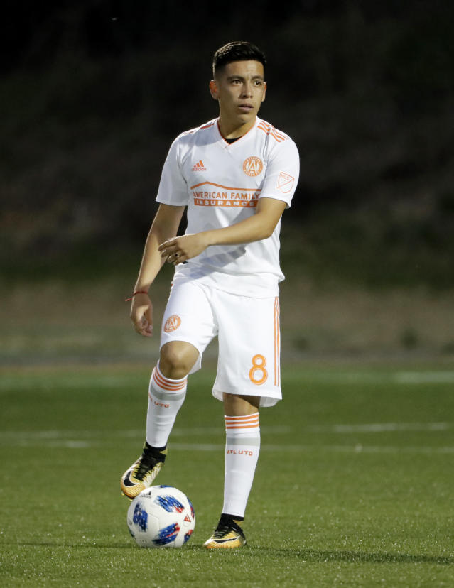 Ezequiel Barco, of Argentina, takes the field for a practice session after being introduced to the Atlanta United MLS soccer team earlier in the day in Marietta, Ga., Thursday, Feb. 15, 2018. Atlanta United has high expectations for a new, young star in its second season after paying an MLS-record transfer fee of $15 million for 18-year-old Barco. Barco joins Atlanta's wave of young stars from South America that also includes Miguel Almiron, Hector Villalba and Josef Martinez. (AP Photo/David Goldman)