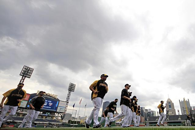 The Pittsburgh Pirates warm up during a baseball workout in Pittsburgh, Saturday, Oct. 5, 2013. The Pirates are scheduled to host the St. Louis Cardinals in Game 3 of the National League division series on Sunday. (AP Photo/Gene J. Puskar)