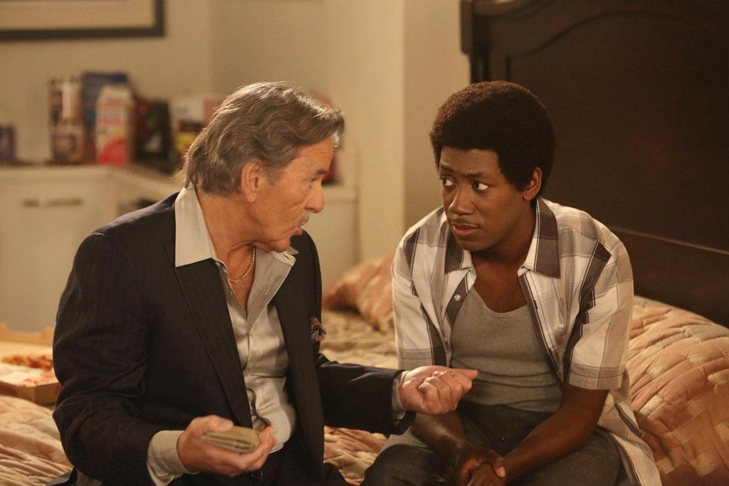 "In a flashback, Walt (guest star Dennis Farina) gives Winston (Lamorne Morris) some fatherly advice in the ""Virgins"" episode of ""New Girl."""