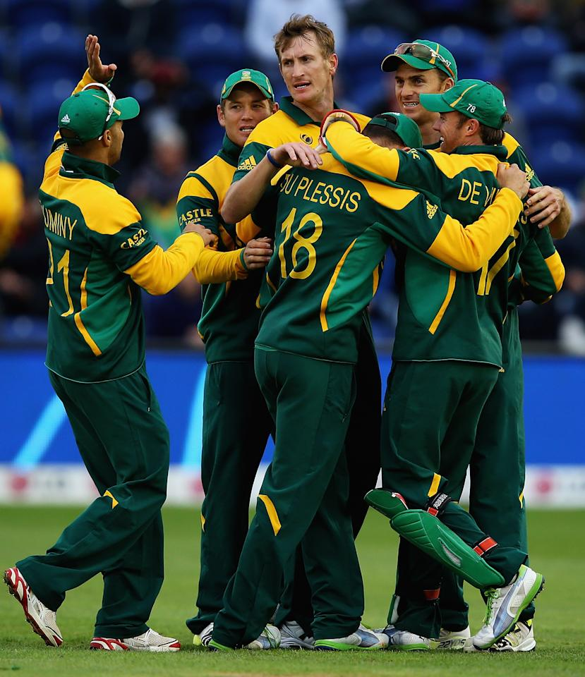 CARDIFF, WALES - JUNE 14:  Faf du Plesis of South Africa is congratulated by Chris Morris, after catching Chris Gayle of the West Indies during the ICC Champions Trophy Group B match between West Indies and South Africa at SWALEC Stadium on June 14, 2013 in Cardiff, Wales.  (Photo by Matthew Lewis-ICC/ICC via Getty Images)