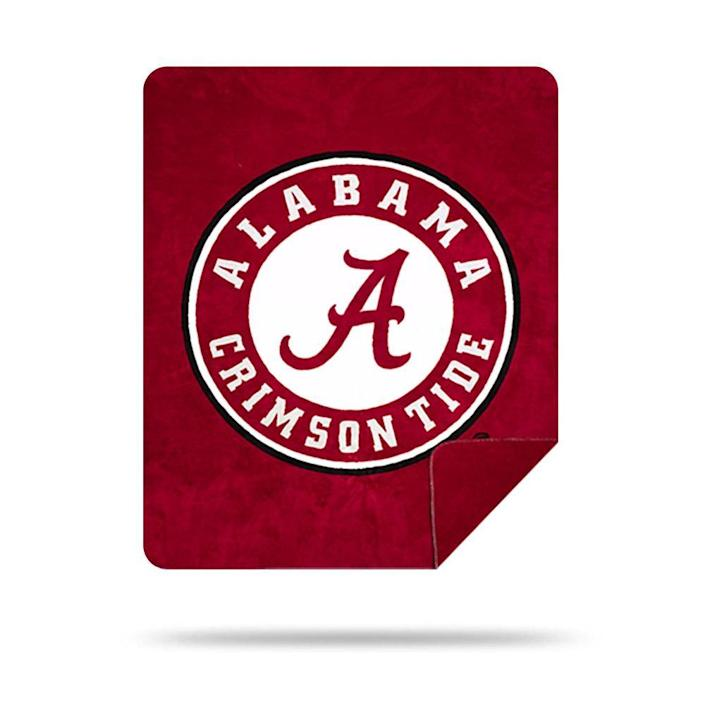 """<p>denalihome.com</p><p><strong>$140.00</strong></p><p><a href=""""https://denalihome.com/collections/college-blankets/products/alabama-crimson-tide"""" rel=""""nofollow noopener"""" target=""""_blank"""" data-ylk=""""slk:Shop Now"""" class=""""link rapid-noclick-resp"""">Shop Now</a></p><p>Help him rep his new school or his favorite team with this 60""""x72"""" blanket. The colors won't run in the laundry, and it gets softer after every wash. (Also available with NFL team logos.)</p>"""