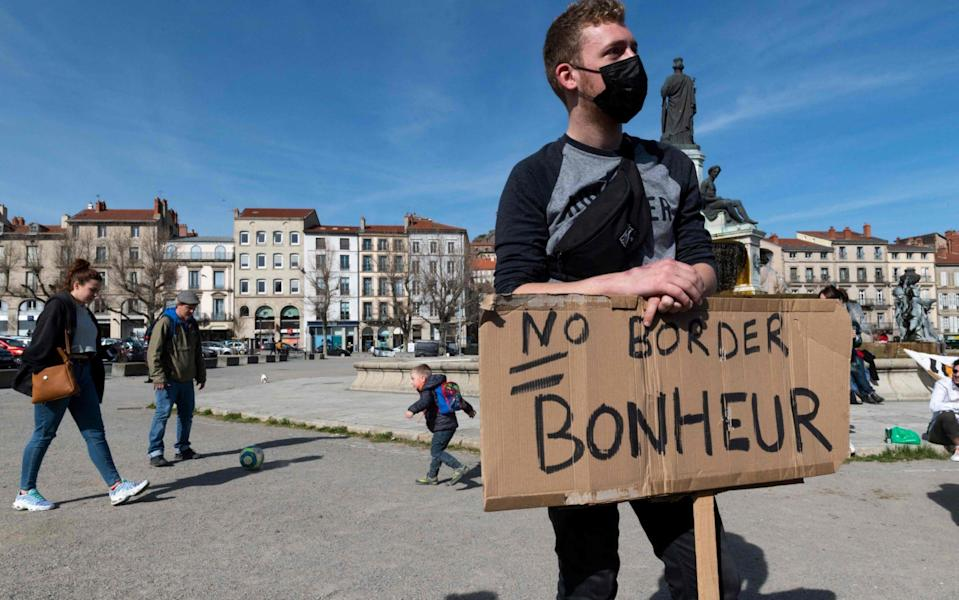 An anti-deportation protester in Le Puy-en-Velay, central France, last month with a placard that reads: