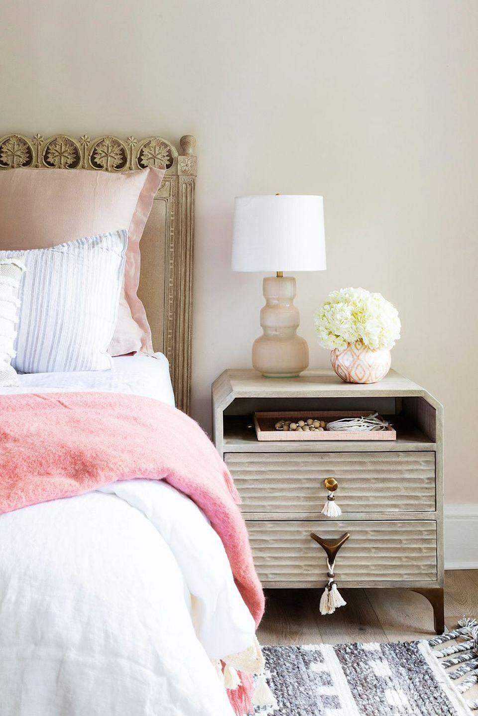 <p>It's all in the details: Hang ivory tassels on drawer knobs to make a modern nightstand look more bohemian. </p>