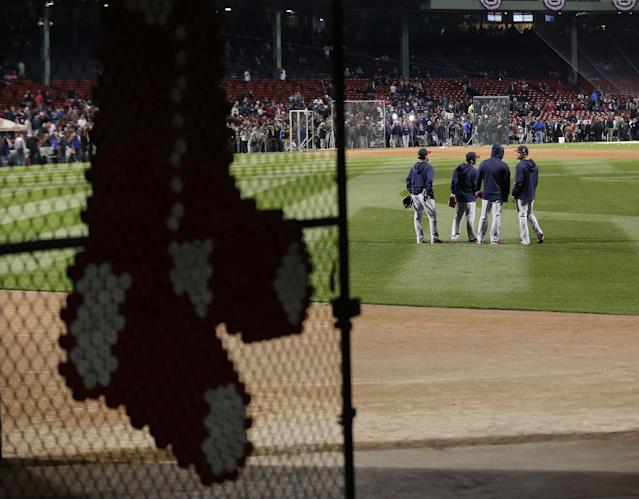 St. Louis Cardinals players stand in the outfield during batting practice before Game 1 of baseball's World Series against the Boston Red Sox Wednesday, Oct. 23, 2013, in Boston. (AP Photo/Charlie Riedel)